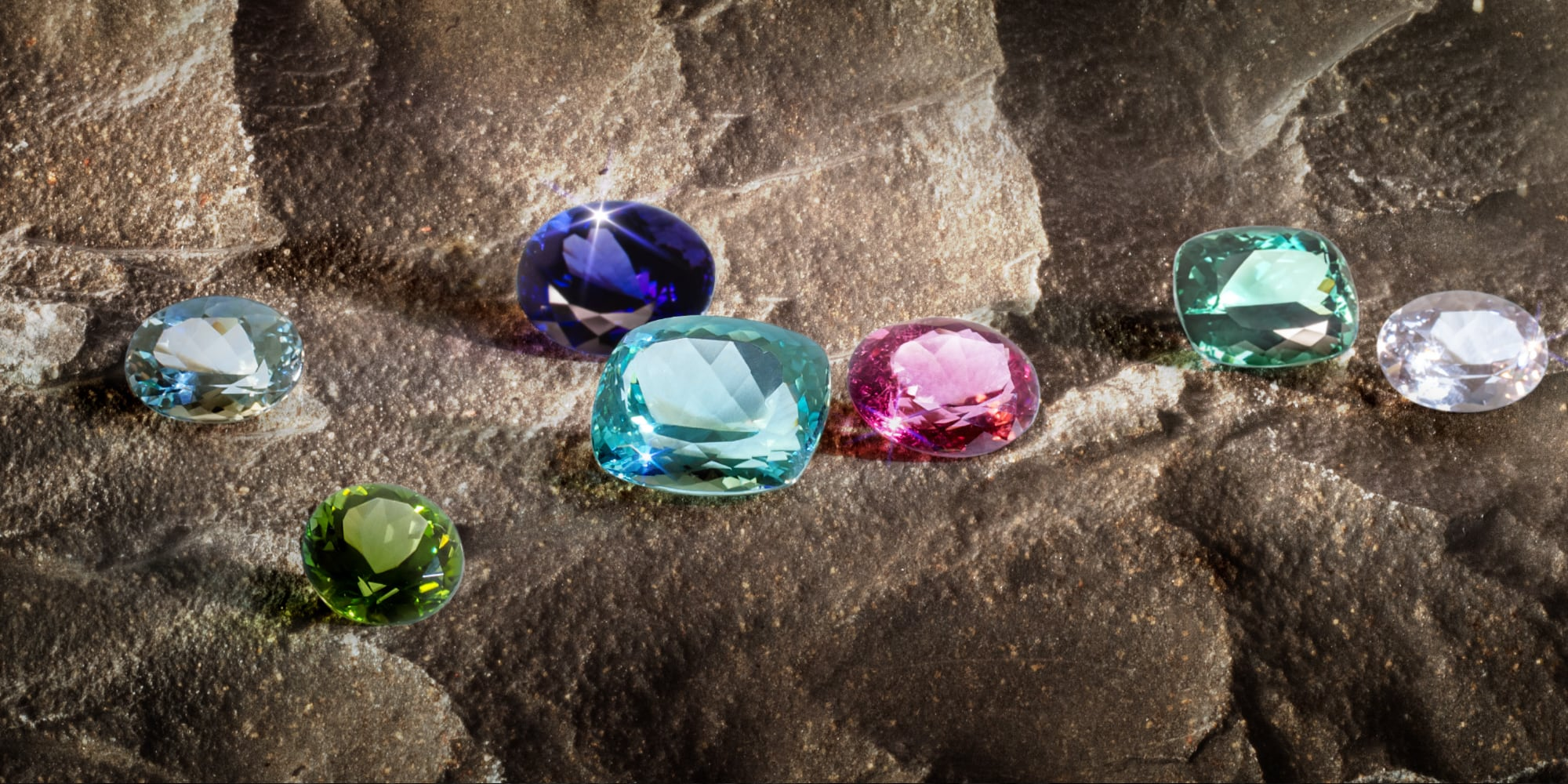 Several gemstones on rocks