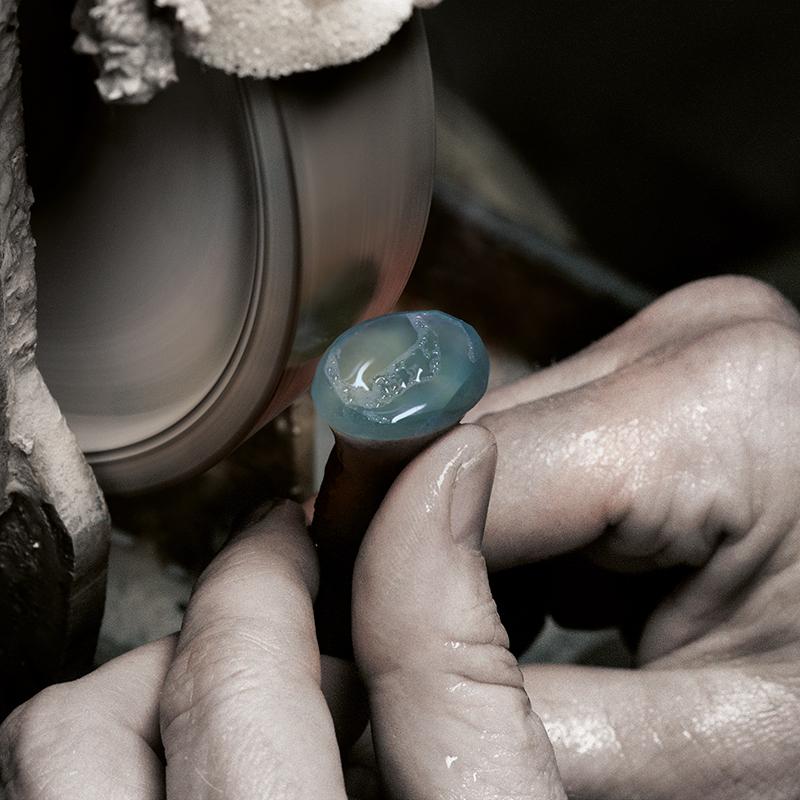 A gemstone is ebouched by a gemstone refiner